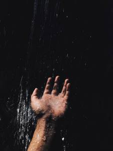 person s left hand catching water
